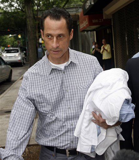 Rep. Anthony Weiner, D-N.Y., carries his laundry to a laundromat near his home in the Queens borough of New York, last week. Sources say he will announce his resignation from Congress.