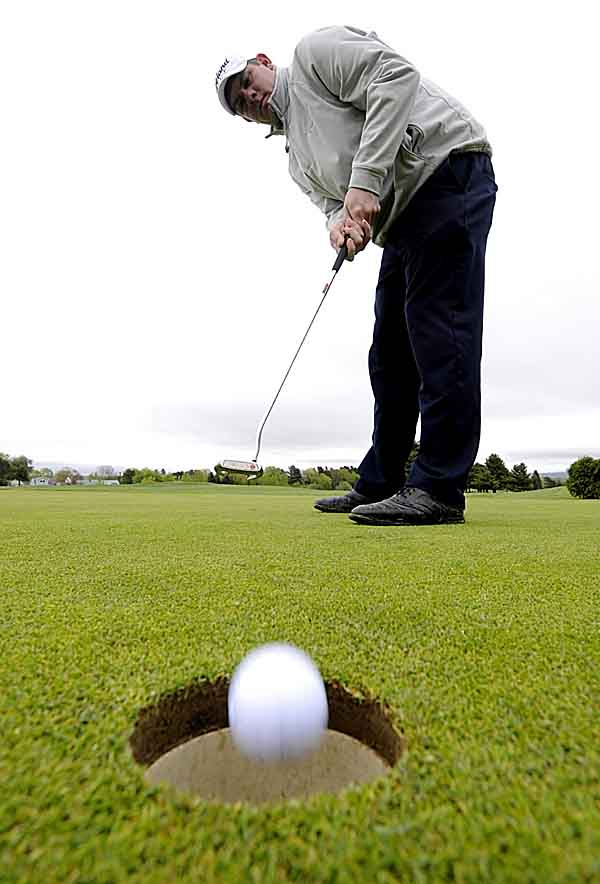 Rob Jarvis, PGA certified golf professional at Bangor Municipal Golf Course, sinks a putt while practicing on the putting green. Jarvis was recently designated as the Maine PGA Chapter 2011 Teacher of the Year.