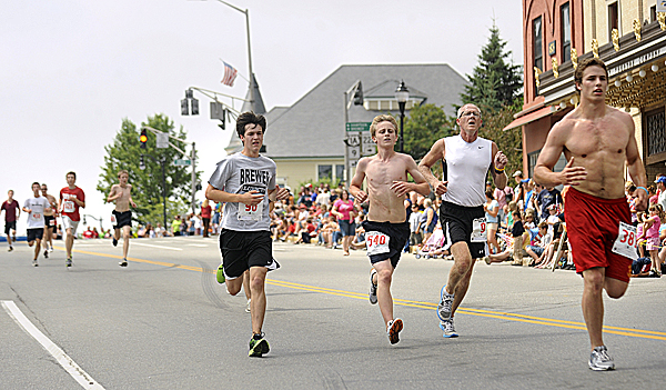 Brewer's Glen Holyoke (second from right) and other runners head down Main Street in Bangor during the Walter Hunt Fourth of July 3K Road Race Monday.
