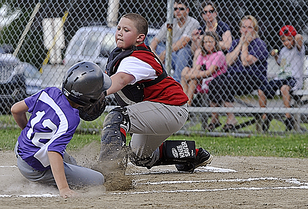 Holbrook's catcher Nate Galinski tags out Hampden's Tyler Knights at the plate during the first inning their Little League All-Star game at Knights of Columbus field in Old Town Tuesday, July 5, 2011.