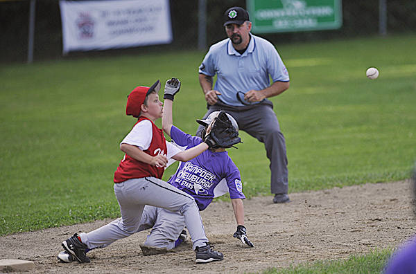 Hampden's Dustin Durrell slides safely to third before Holbrook's Ben Tyler can get the ball during the first inning of their Little League All-Star game for ages 10-11 at Knights of Columbus field in Old Town Tuesday afternoon, July 5, 2011.