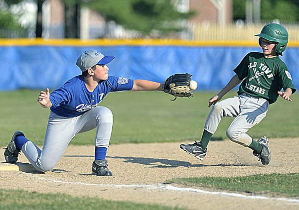 Third baseman Eric Byers of the Hermon ages 9-10 Little League all-star team takes the throw to tag out Old Town's Dakota Madden during Wednesday's District 3 game at the 13th Street Field in Bangor.