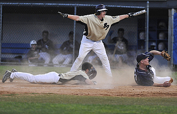 "Brewer's Nick Moore (center) said ""safe"" but the umpire (not pictured) called his teammate Brandon Gendreau out after being tagged by Bangor Comrades pitcher Jesse Wood (right) in the third inning of their American Legion baseball game at Mansfield Stadium in Bangor Tuesday evening, July 12, 2011. Gendreau tried to score on a wild pitch."