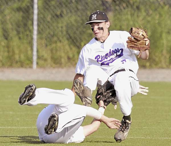 Hampden River Dog Evan Kingsbury (top) collides with teammate Derrick Bernosky after making a catch in the sixth inning of Sunday afternoon's American Legion baseball Zone 1 tournament game against Brewer at Winkin Stadium in Bangor. Brewer won 7-2.