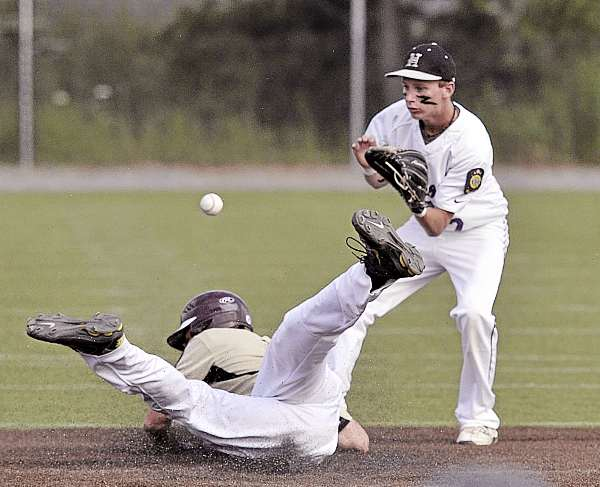 Vance Eldridge of the Brewer Falcons barrels into second with a stolen base as Hampden's Reed McGinley awaits the throw in the fourth inning of Sunday's American Legion baseball Zone 1 tourney game at Winkin Stadium in Bangor. Brewer won 7-2.