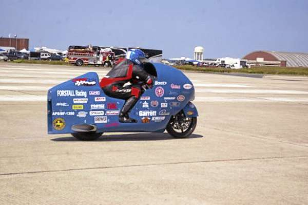 Bill Warner of Winauma, Fla., leaves the starting line at Loring Air Force Base in Limestone on his highly modified turbocharged Suzuki Hayabusa motorcycle en route to setting the world land speed record for motorcycles at 311.945 miles per hour.