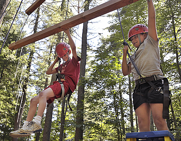 Strong Mind-Strong Body Inc. camp participants Derek (left) and Megan were two of the first participants climbing up the rope course at the University of Maine in Orono last week. They participated in a weeklong wellness- and nutrition-oriented summer day camp held on the Orono campus in conjunction with the university's Conference Services Division.