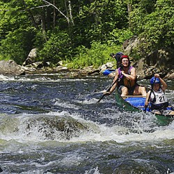 Photo Courtesy of Fiona Sorensen Laurie Hamilton and Laurie Stearns compete in the Junior-Senior class at the national whitewater championship last week on the Deerfield (Mass.) River. They went on to win their division.