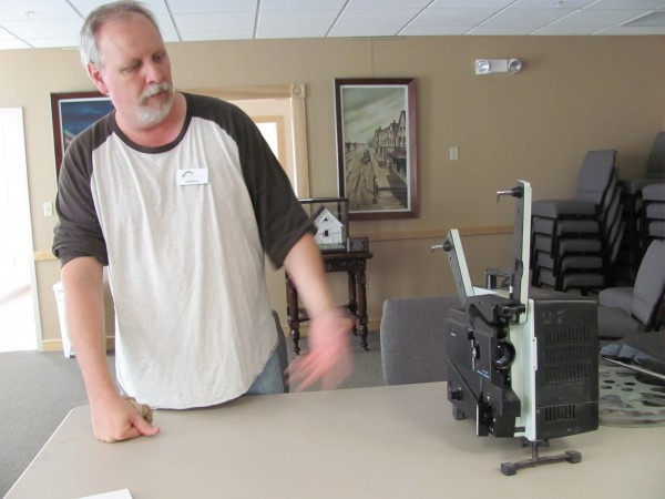 John Bessey, a volunteer for the Newport Cultural Center, gives a reel-to-reel movie projector a test run on Friday, July 22, 2011. The cultural center will debut an old movie night Friday that will benefit from an anonymous donor's collection of films.