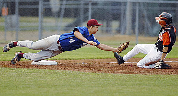 Bangor third baseman Nic Ashey tags out Brewer's Ian Forrest on an attempted steal in third-inning action of the District 3 Senior League championship game at Mansfield Stadium in Bangor Tuesday night. Brewer beat Bangor 4-2 to win the title.