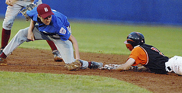 Bangor second baseman Reed Brookings is late with the tag in the fourth  inning on Brewer's Matthew Morrow during the District 3 Senior League championship game Tuesday night at Mansfield Stadium in Bangor. Morrow reached on a fielder's choice grounder and advanced on an errant throw to first.