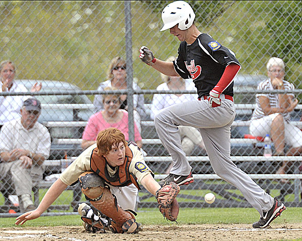 Brewer catcher Nick Moore collects a late throw to the plate as Morrill Post's Evan Indorf scores in the fifth inning of their state Legion playoff game in Augusta Friday. Brewer won 8-3.