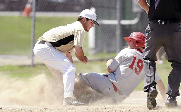 Brewer third baseman Eric White tags out Gayton Post's Corbin Hyde after Hyde doubled in two runs and tried to reach third during the third inning of their state American Legion tourney game in Augusta Sunday. Gayton Post of Lewiston eliminated Brewer 8-7.