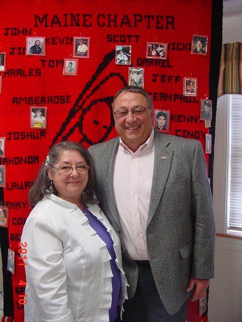 Mary Farrar poses for a photo with Gov. Paul LePage at a meeting of victim advocates held earlier this year. Farrar will receive a national award next month for her work from Parents of Murdered Children.