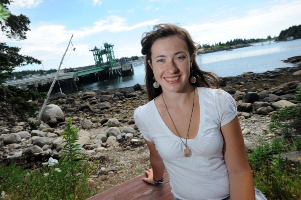 Kasssandra Hopkins has a lot to smile about as she poses for a photograph along the shore of her home, Vinalhaven, on Sunday, July 24, 2011. At 16, she has been granted a scholarship worth $250,000 toward her future education. She has dreams of entering the medical field and becoming a surgeon.