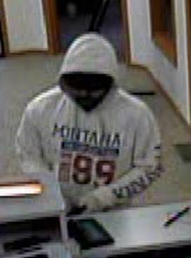 An image taken from video at the Down East Credit Union in Unity, Maine, shows a robbery suspect on Friday afternoon, July 29, 2011.
