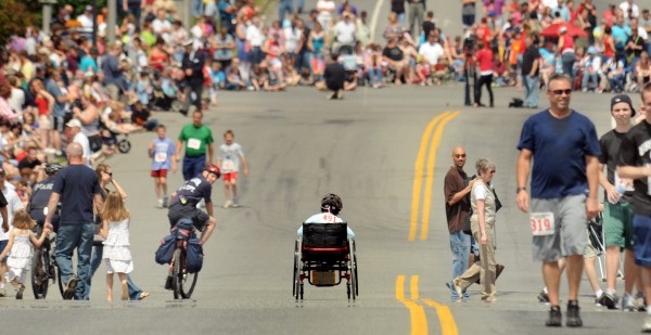 Anna Morey of Bangor competes in her wheelchair during the annual Walter Hunt Memorial Fourth of July Road Race in Bangor Monday.  The 3000 meter race follows the route of the 4th of July Parade from Brewer to Bangor.