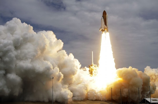 The space shuttle Atlantis lifts off from the Kennedy Space Center on Friday.