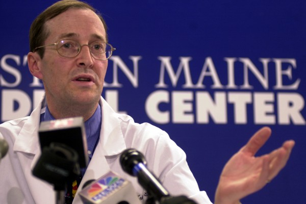 Dr. Erik Steele holds a press conference at EMMC in May 2003.