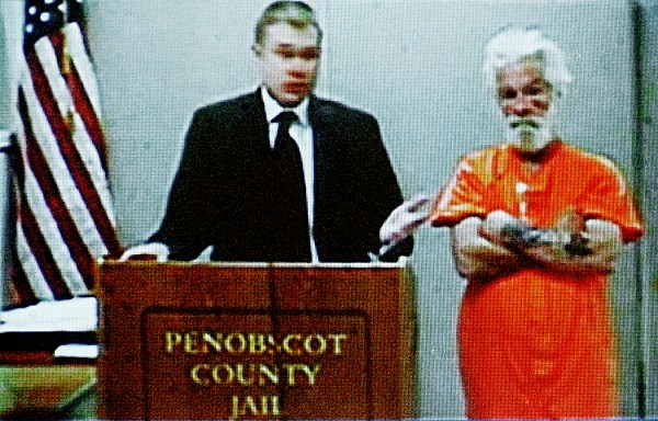 A video screen displays Edward Myshrall, right, and his attorney Aaron Frey during Myshrall's video appearance before Superior Court Justice Kirk Studstrup at Penobscot Judicial Center in Bangor Wednesday afternoon, July 13, 2011. Myshrall, 52 of Bangor made his initial court appearance  was charged with aggravated assault and failure to submit to arrest earlier this week.