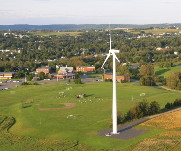 The wind turbine at the University of Maine at Presque Isle looms over the soccer and baseball fields at the university in May 2010. UMPI officials met Tuesday, Oct. 11 with the general contractor who installed the 600-kilowatt wind turbine to try to determine why it has been useless much of the spring and summer.