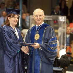 Amy Smith, the 2010 University of Maine valedictorian, gets her diploma from UMaine president Robert Kennedy.