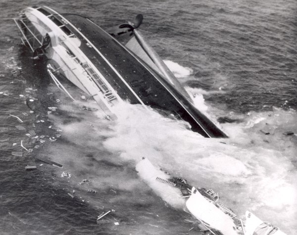 Harry Trask of the Boston Traveler made this photograph as the Andrea Doria sank on July 26, 1956 in the Atlantic Ocean, 45 miles south of Nantucket Island. The image was widely distributed by the Associated Press.