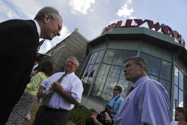 Standing in front of the Hollywood Slots facility in Bangor, Hollywood Slots Hotel and Raceway general manager John Osborne (left), Rep. Douglas Damon, R-Bangor, and Bangor Region Chamber of Commerce president John Porter (right) catch up with each other after Monday's press conference in which they and fellow table game supporters in Penobscot County launched their campaign. Rep. Damon is a bill sponsor of LD 1418 which Gov. LePage signed earlier this month. LD 1418 is an act to allow table games at a licensed slot facility.