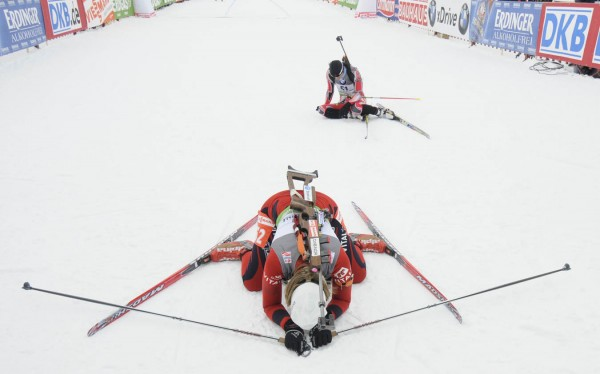 """World Cup Biathlon"" is the third place photo in the Sports Feature category in Class I of the 2011 New England Associated Press News Executives Association contest. In this photo, Fanny Welle-Strand Horn (foreground) of Norway and Rosanna Crawford of Canada collapsed after finishing the  women's 7.5 kilometer sprint competition at the I.B.U. World Cup Biathlon at the Nordic Heritage Center in February 2011."
