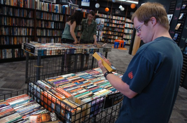 Stephen Costello of Old Town browses the books at Bull Moose in Bangor on Wednesday, July 20, 2011. The Maine-based Bull Moose chain started as a music store in the late 1980s, later expanding to include DVD, video games and books.