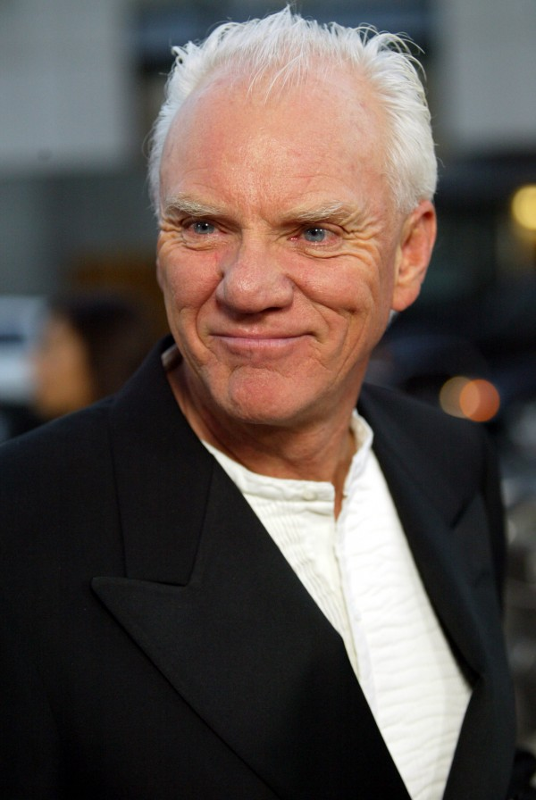 "Actor Malcolm McDowell poses for a photo as he arrives for the LA world premiere of ""Bobby Jones-Stroke of Genius,"" in April 2004. The Maine International Film Festival honored McDowell Saturday night with its Mid-Life Achievement Award — a hand-crafted moose by Laurel McLeod — and in turn, McDowell honored his great friend, director Lindsay Anderson."