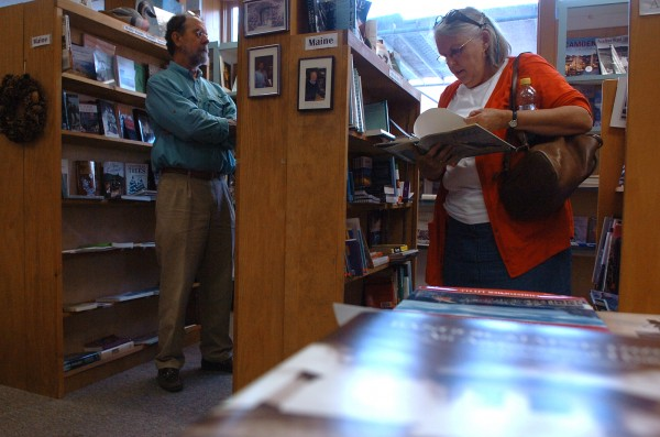 Bruce and Judy Marsh, seasonal residents of Greenville, browse Maine books at BookMarcs Bookstore and Cafe in Bangor on Wednesday.