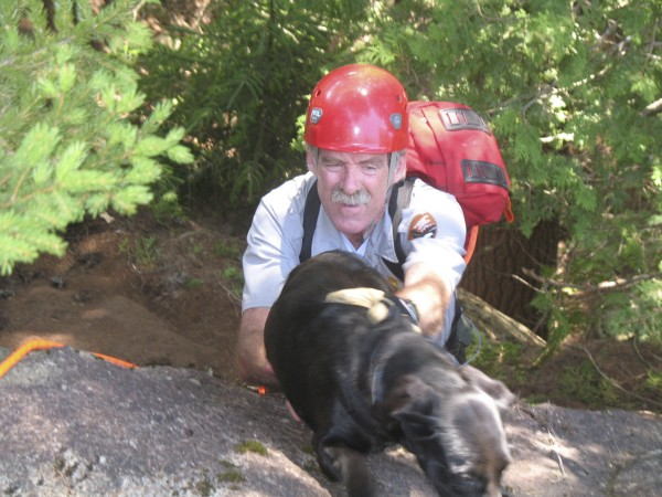 Bailey, an 8-month-old puppy who was stranded for up to four days on a ledge in Acadia National Park, was rescued Friday, July 29, 2011 by several park rangers including Ranger Ed Pontbriand.