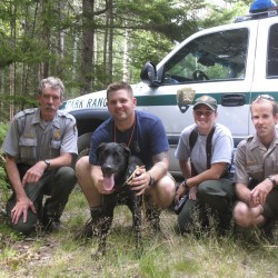 Bailey, an 8-month-old puppy who was stranded for up to four days on a ledge in Acadia National Park, was rescued Friday, July 29, 2011 by several park rangers including (from left to right) Ranger Ed Pontbriand, Ranger Jed Fiske, Ranger Heidi Greenleaf and Ranger Jacob Poley.