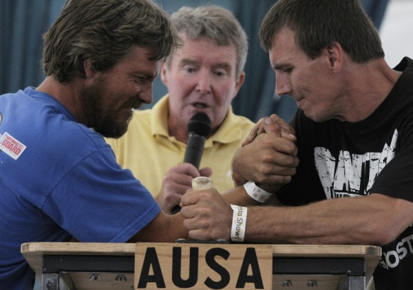 Kevin Young, left of Glenburn and Stu Hatch, right, of Clifton were among the finalists in the Bangor Arm Wrestling Classic at the Bangor State Fair Saturday afternoon, July 30, 2011. Officiating the event was Steve Simons, center, of Carlsbad, CA who runs Arm Wrestling U.S.A.