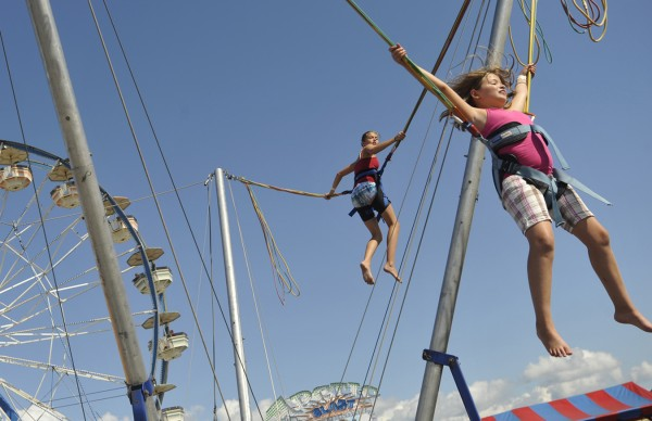 Krista Butler (foreground, right) , 9 of Cushing and others appear to defy gravity at the &quotBungee&quot attraction at the Bangor State Fair Saturday afternoon, July 30, 2011. Krista came to the fair with her grandparents Bob and Liz Delano, aslo of Cushing as well as her brother Reese,4 and sister Cassie, 12. The Bangor State Fair kicked off Friday, July 29 and continues through Sunday, Aug. 7.