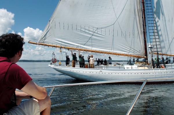 In this July 2008 photo, Maine Maritime Academy junior Matt Garand, aboard the boat Mischief, exchanges greetings with students and crew members on the schooner Bowdoin, which was returning to Castine after a 60-day trip to the Arctic. MMA will mark the schooner's 90th birthday on Sunday in Castine.