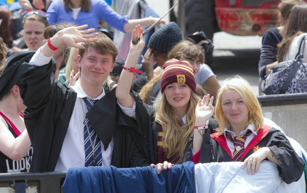 Harry Potter fans, left to right, Ross Peters, 17, Lauren Furness, 16, both from Nottinghamshire  and Jodie Thornes, 18, from the Isle of Wight, join fans waiting at Trafalgar Square, London, a day before the World Premiere of Harry Potter and The Deathly Hallows: Part 2, the last film in the series, Wednesday, July 6, 2011.