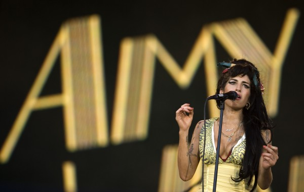 Singer Amy Winehouse of England performs during the Rock in Rio music festival in Arganda del Rey, on the outskirts of Madrid on July 4, 2008. British police say singer Amy Winehouse has been found dead at her home in London on Saturday, July 23, 2011. The singer was 27 years old.