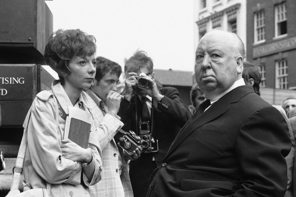 British film producer and director Alfred Hitchcock, right, discusses filming with actress Anna Massey, one of the stars of &quotFrenzy&quot, in Covent Garden Market, London in July 1971. Massey, an acting dynasty member whose roles ranged from lonely spinsters to Margaret Thatcher, has died at 73. Massey's agent, Pippa Markham, says she died Saturday, July 2, 2011, after a battle with cancer.