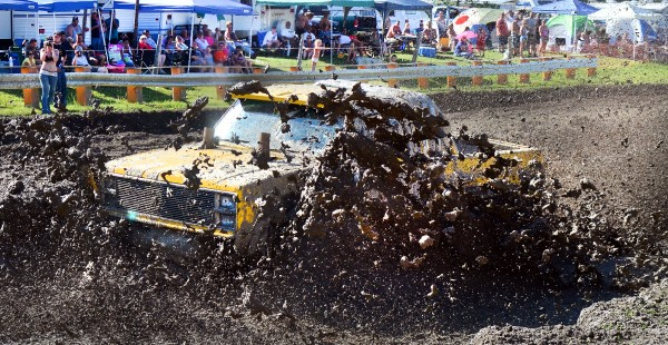 A competitor is enveloped as he tries to make his way through the deep mud Saturday afternoon at the Firecracker 4x4 at the Barnyard in Livermore.