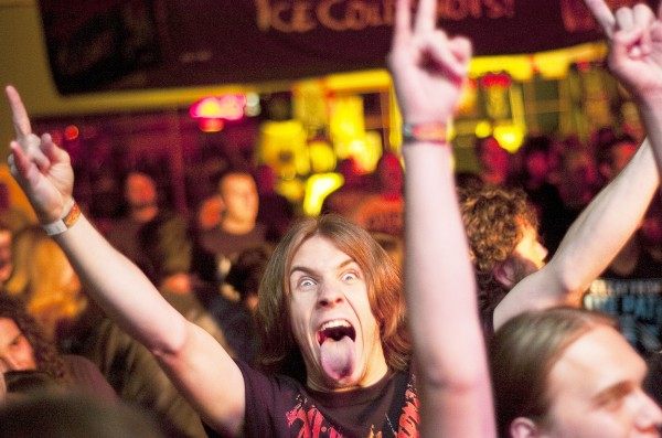 A heavy metal fan, possessed by the music, at Club Texas in Auburn on Tuesday.