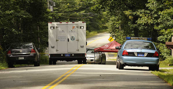 Maine State Police investigate the crime scene on Bennett Rd. in New Gloucester on Tuesday.
