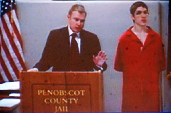 A video screen displays Danny Adams, right, of Pittsfield and his attorney Aaron Frey during Adams' video appearance at Penobscot Judicial Center in Bangor Wednesday afternoon, July 13, 2011. Adams is accused of stealing a car, crashing it, and hiding in a nearby wooded area in Corinna on Saturday, July 9.