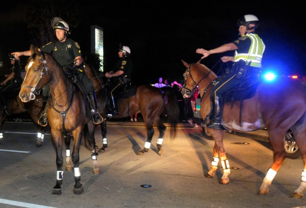Mounted officers from the Orange County Sheriff's Department move protesters off the street as Casey Anthony was released from the Orange County Jail in Orlando, Fla., Sunday, July 17, 2011.