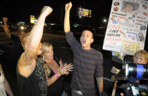 Protesters show their displeasure after Casey Anthony was released from the Orange County Jail in Orlando, Fla., early Sunday, July 17, 2011.