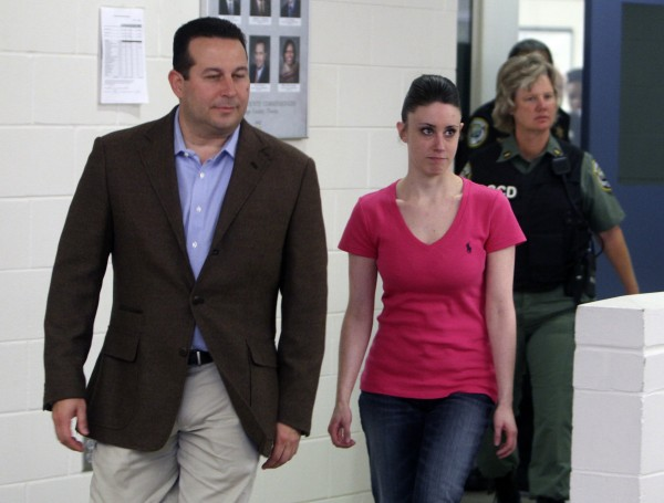 Casey Anthony (front right) walks out of the Orange County Jail with her attorney Jose Baez (left) during her release in Orlando, Fla., early Sunday, July 17, 2011. Anthony was acquitted last week of murder in the death of her daughter, Caylee.