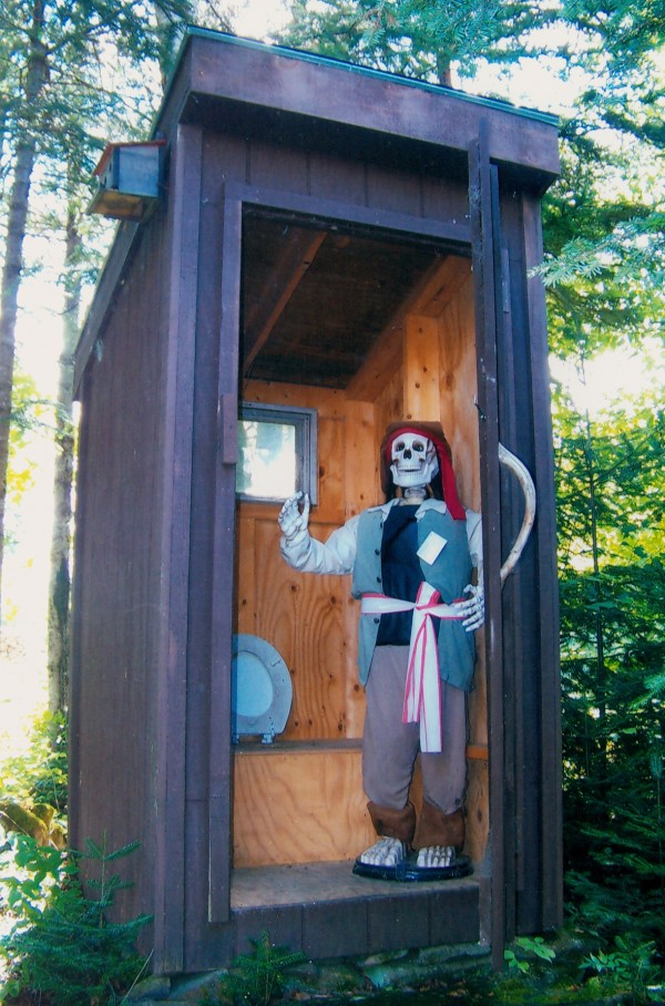This outhouse was built 20 years ago. Two years ago at a family reunion we rigged the Halloween skeleton with a fishing line hooked to the door and hand of the skeleton to raise as you open the door. When family and guests came, we told them to open the door and see how cute we fixed it up. Needless to say many screams were bought forth, and laughs.