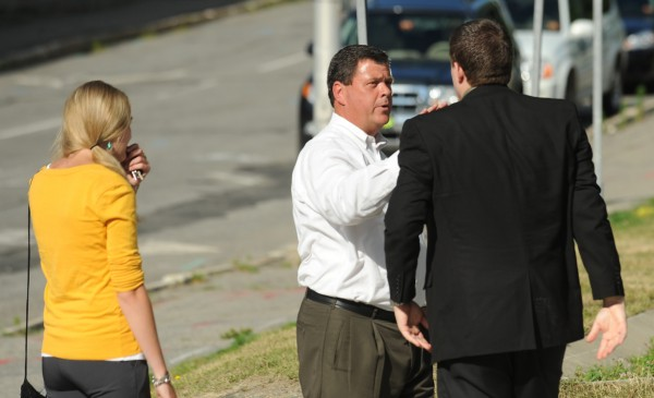 Jordyn Bakley's father, J.C. Bakley, says goodbye to Brandon Robitaille (right) after Garrett Cheney was found guilty at the Penobscot Judicial Center in Bangor on Thursday, July 28, 2011. The jury found Cheney guilty of all charges in the hit-and-run death of Jordyn Bakley.
