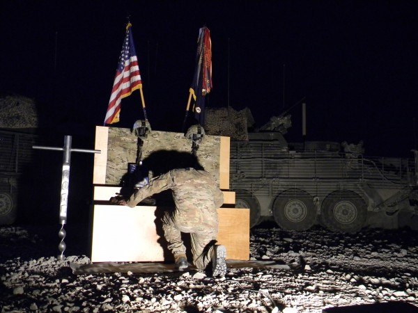 Chaplain (Cpt.) Mark Olsen offers a final prayer at the memorial for two Soldiers of 3rd Battalion, 21st Infantry Regiment, Gimlets at FOB Zangabad, Afghanistan, 20 July.
